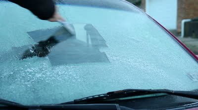 Stock Footage Scraping Off The Ice On A Car S Windshield On A Cold Winter Morning
